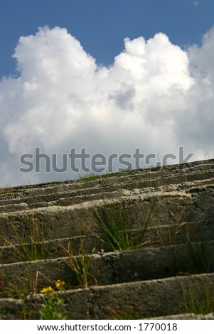 Concrete stairs to clouds