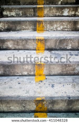 Concrete stairs yellow line dividing the middle. - stock photo