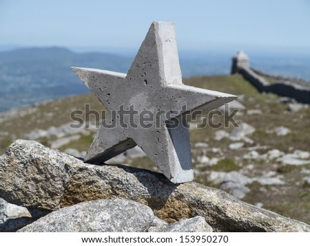 concrete star atop summit cairn of slleve meelmore one of the highest mountains in ireland - stock photo