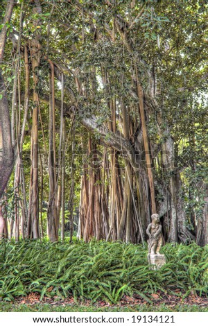 Concrete Statue in Banyan Tree Garden at Ringling Mansion in Sarasota, Florida. (The Banyan trees were a gift from Thomas Edison to John and Mable Ringling during the 1920's)