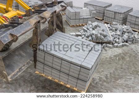 Concrete stones for the sidewalk pavement, concrete bricks. Selective focus. - stock photo