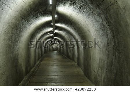 concrete tunnel with lamps