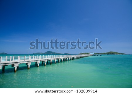 Concrete walk bridge across the sea with the blue sky at rawai beach, phuket Thailand - stock photo