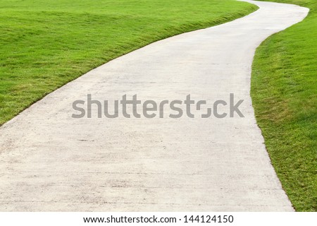 Concrete walking way in golf course - stock photo