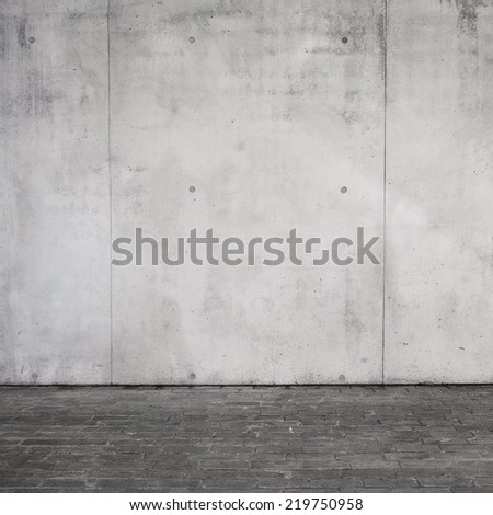 Concrete wall and brick floor texture - stock photo