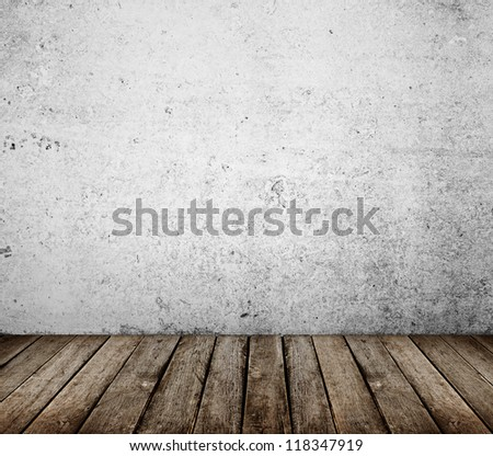 concrete wall and brown wood floor