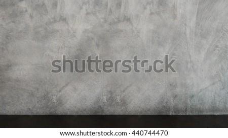 concrete wall texture abstract background with wood table : copy space for word : dark tone
