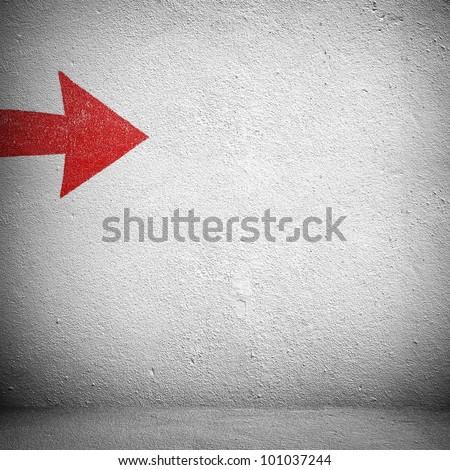 concrete wall with arrow - stock photo