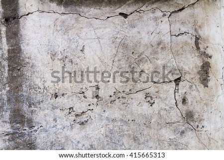 concrete wall with cracks. gray background cement texture