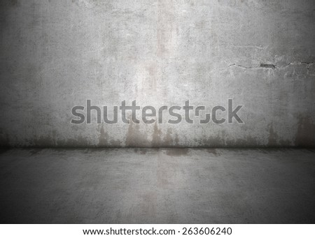 Concrete wall with dirty stains and grungy lighting and shadows. Lots of copy space, perfect for design background. - stock photo