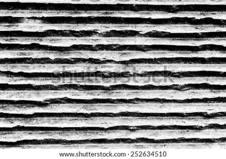 Concrete wall with horizontal black and white stripes - stock photo