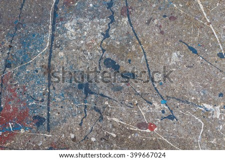 Concrete wall with the spilled paint.  - stock photo