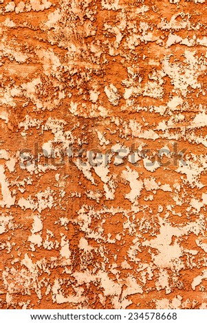 Concrete, weathered, worn, painted yellow and orange. Grungy Concrete Surface. Great background or texture. - stock photo