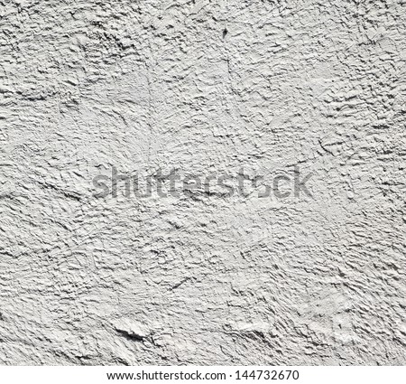 concrete white cement wall with a crumble texture  - stock photo