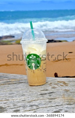 CONDADO, PUERTO RICO - JANUARY 24, 2016: A Starbucks coffee on the beach in Condado, Puerto Rico. Starbucks Corporation is an American coffee company and coffeehouse chain. - stock photo