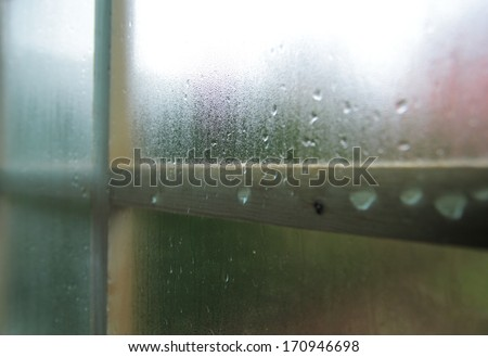 Condensation and raindrops on a window, shallow depth of field.