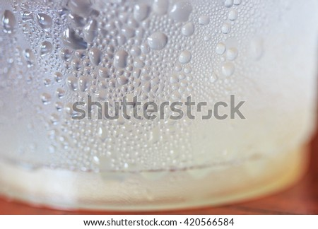 Condensation forms water droplets on the glass - stock photo