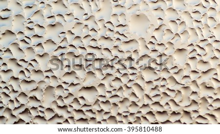 Condensation forms water droplets on the surface of a clear glass house interior window. Silver white and grey colours provide the overall theme. Copy space area for architecture domestic concepts - stock photo