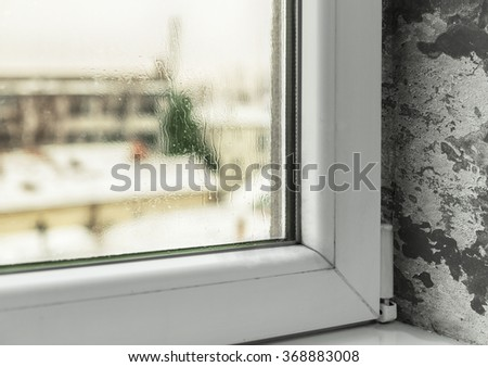Condensation in windows cause mold and moisture in the house - stock photo