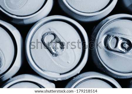 Condensation on the top of cans of drinks. - stock photo