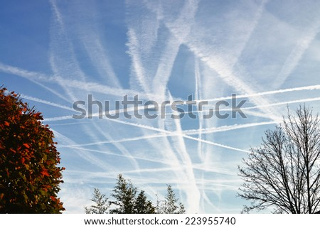 Condensation Trails In The Sky - stock photo