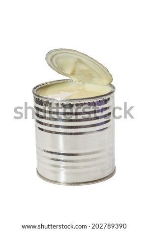 Condensed milk in tin can on white background  - stock photo