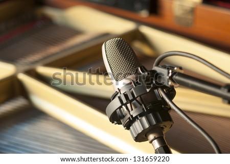Condenser microphone inside a piano - stock photo