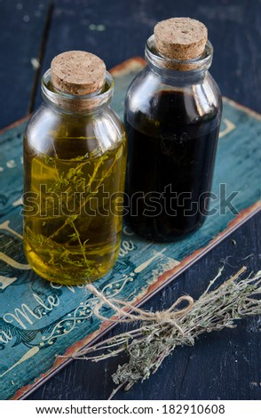 Condiments. olive oil and balsamic vinegar and dried thyme on wooden table  - stock photo