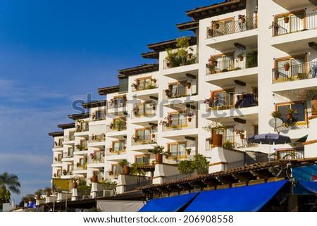 condo building from Puerto Vallarta marine - stock photo