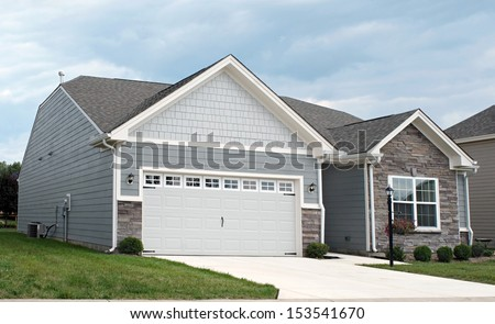 Condo with Two-car Garage - stock photo
