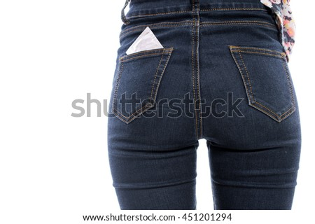 Condom in a pocket female jeans isolated on white background. Safe sex concept.