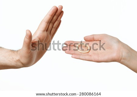 condom in female hand, men's hand showing stop - stock photo