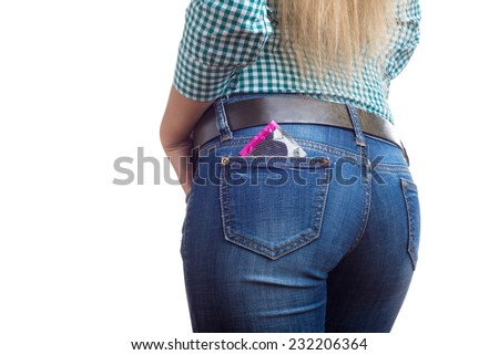 condom in jeans pocket - stock photo