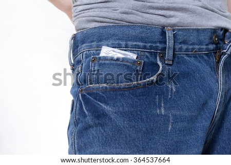 Condom in the pocket of blue jeans on isolated white background