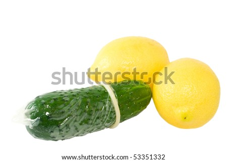 condom on a cucumber and two lemons isolated on white