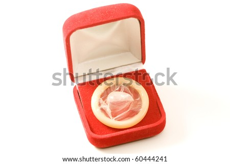 Condom or rubber in a red gift box - stock photo