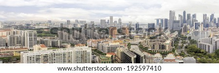 Condominiums Along Singapore River with Central Business District Skyline Panorama - stock photo