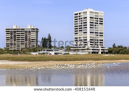 Condominiums buildings along the shore line of Siesta Key beach. Florida outside of Sarasota. - stock photo