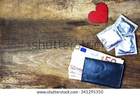 condoms and red love heart, Check folder with euro  on wooden background. space for text. valentine days, dating, Sex sales, prostitution concept - stock photo