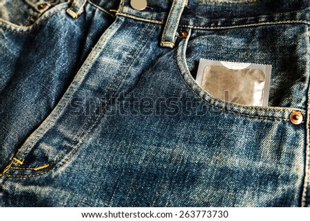 Condoms In jeans pocket for Safe sex - stock photo