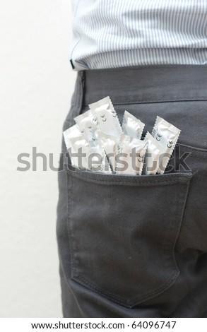 Condoms in the back pocket - stock photo