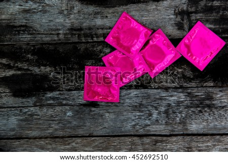 condoms on wooden background. space for text. Making love concept - stock photo