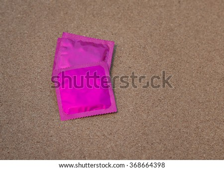 condoms on wooden table background, soft and selective focus. - stock photo