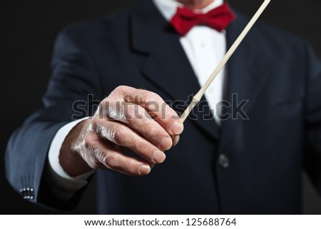 Conductor conducting an orchestra isolated. - stock photo