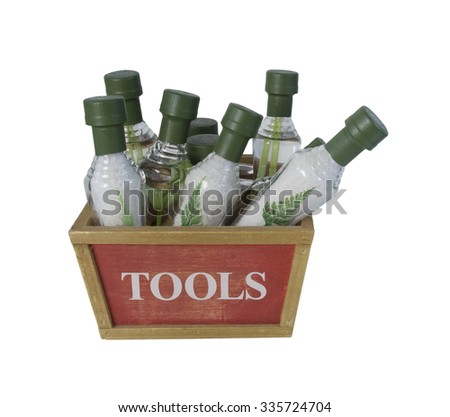 Cone Shaped bottles that contain bath salts in a Tool Box to show the proper tools for a relaxing bath - path included - stock photo