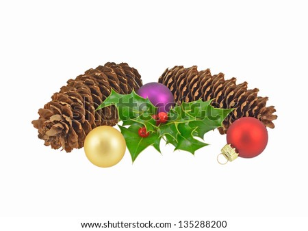 Cones with holly and festive baubles - stock photo