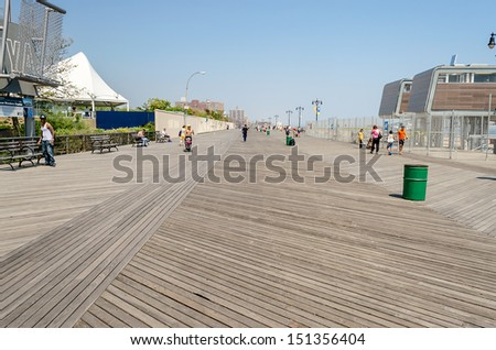 CONEY ISLAND - MAY 30: Coney Island Boardwalk seen on May 30, 2013. The 2.51 mile seaside boardwalk has drawn visitors since 1923, still hosting famous amusement parks as long as the New York Aquarium - stock photo