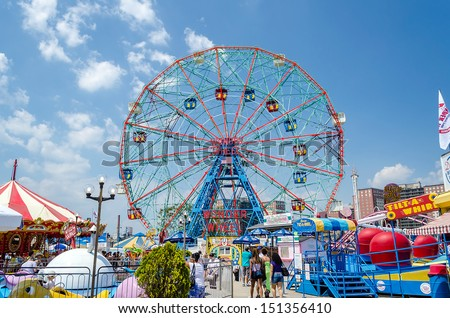 CONEY ISLAND - MAY 30: The famous Wonder Wheel in Coney Island, May 30, 2013. The Eccentric Ferris Wheel was built in 1920, it has 24 fully enclosed cars,giving a total capacity of 144 passengers