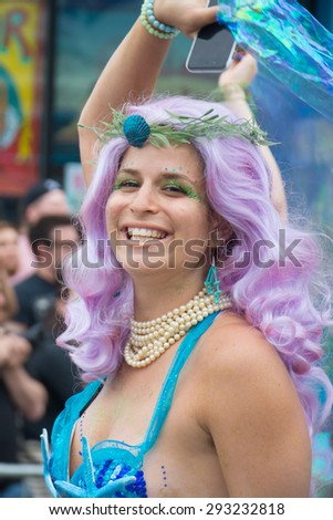Coney island, New York City; June 20, 2015: Woman at the Mermaid parade, the largest art parade in the nation and a celebration of ancient mythology and honky-tonk rituals of the seaside.
