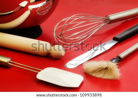 confectioner utensils over red silicone - stock photo